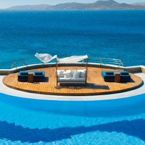 Mykonos Grand Hotel - Pool Area with wooden Deck